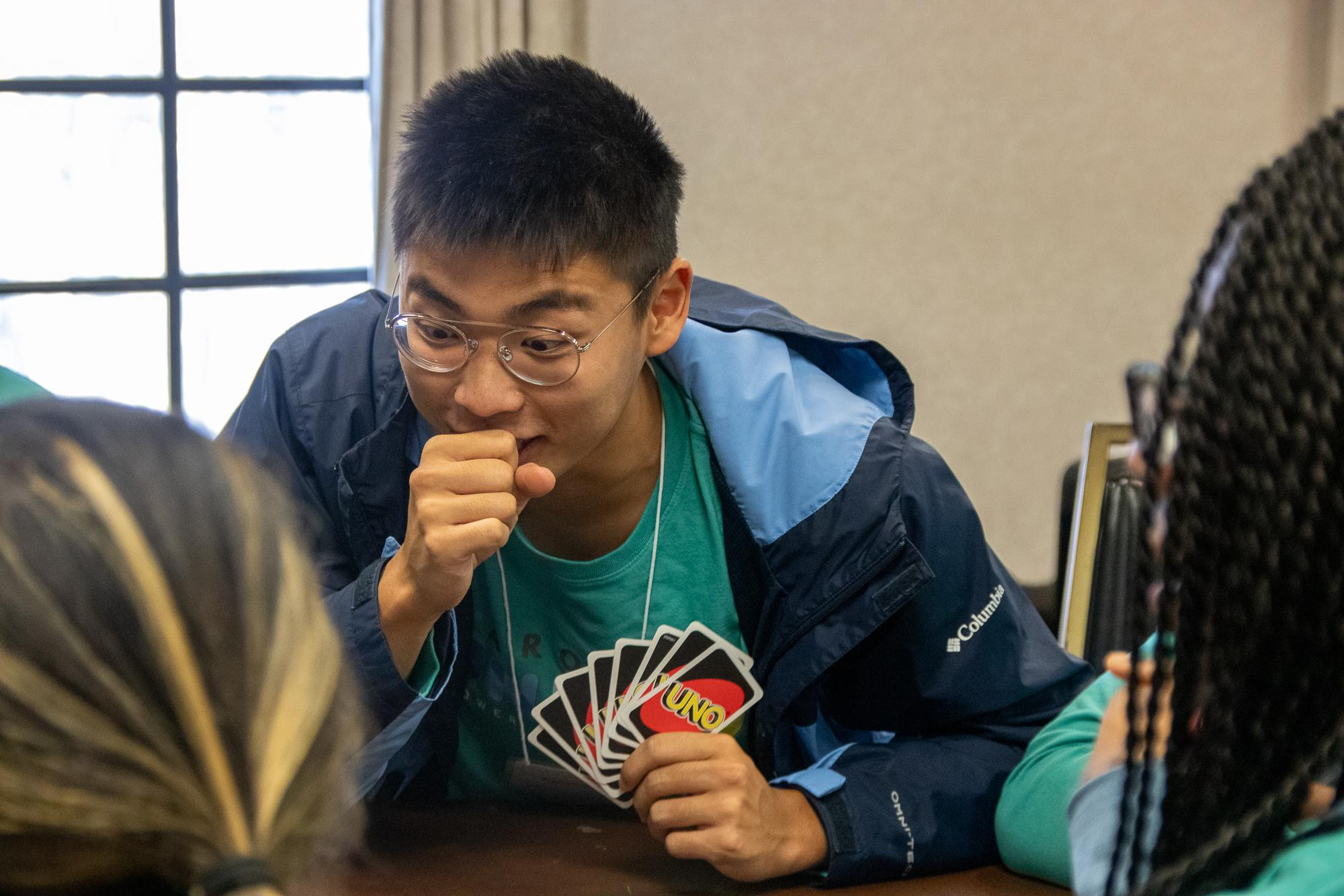 Student amazed at card game
