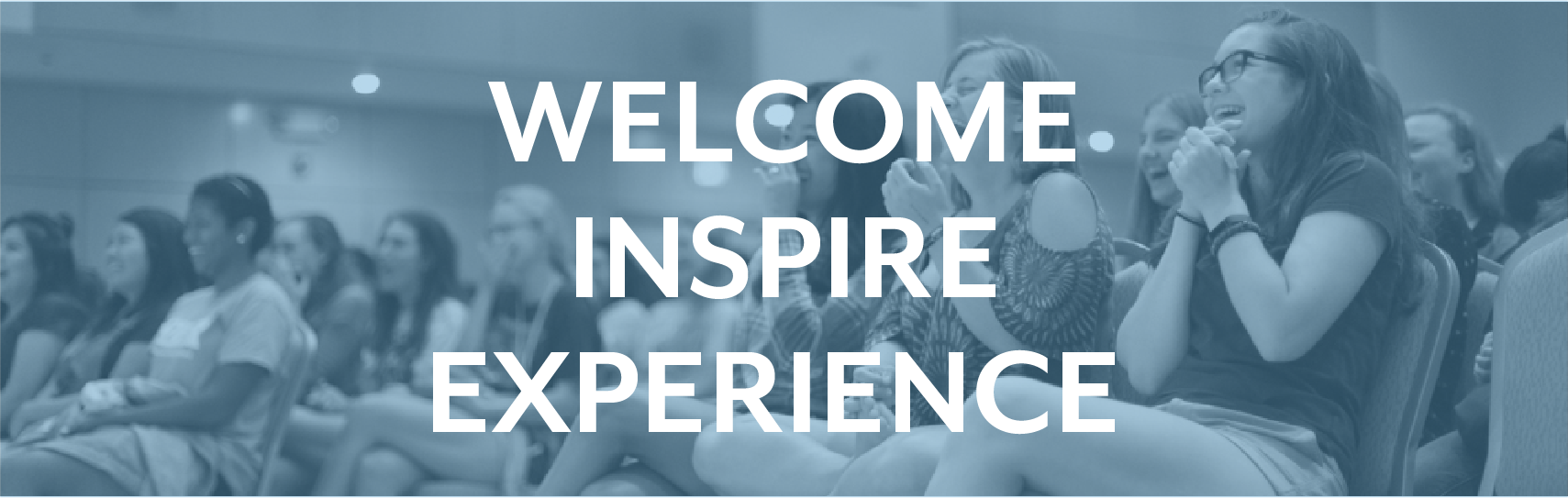 "Crowd of people clapping in the great hall, with the words ""welcome inspire experience"""
