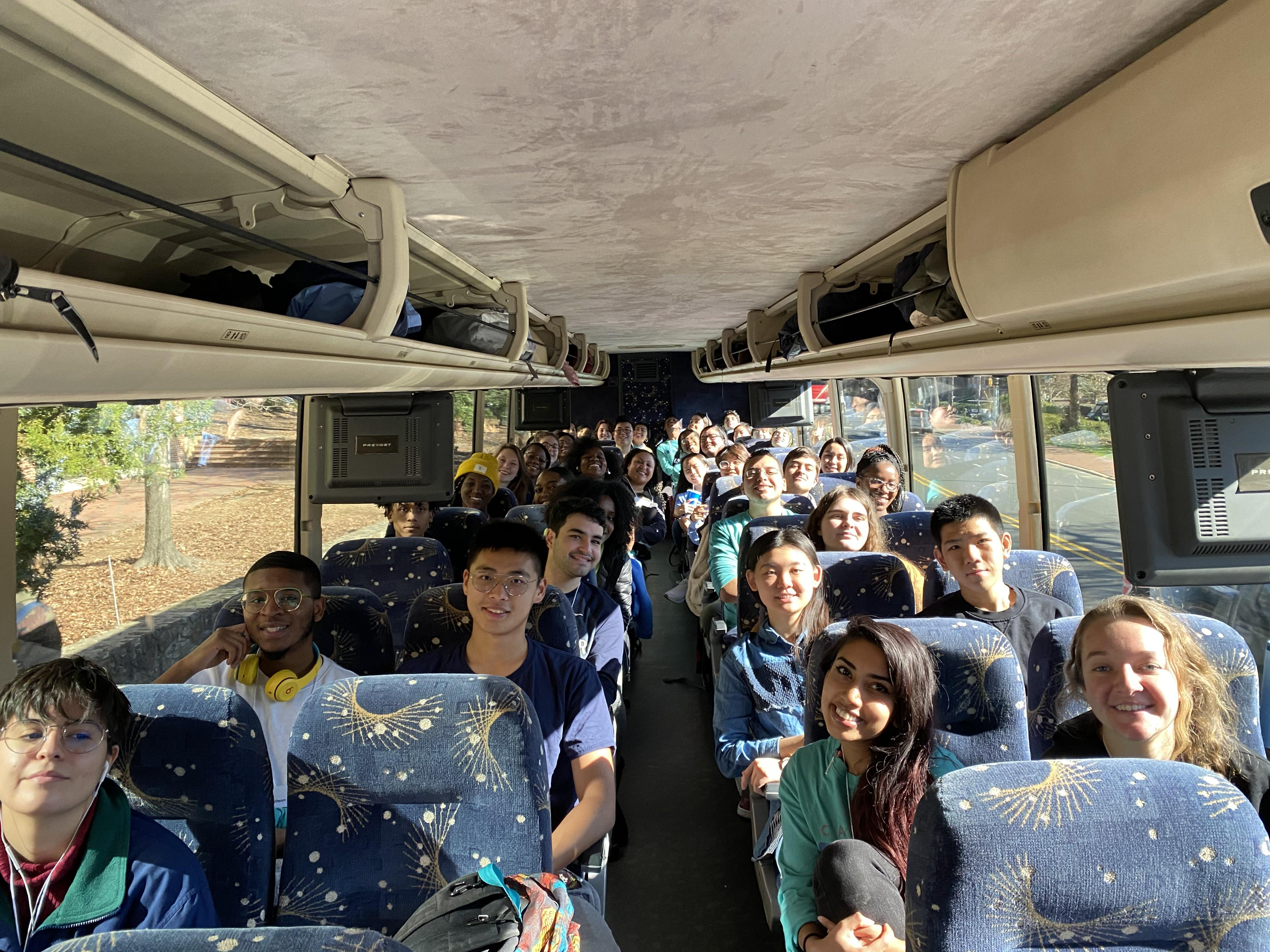 Students smiling on bus