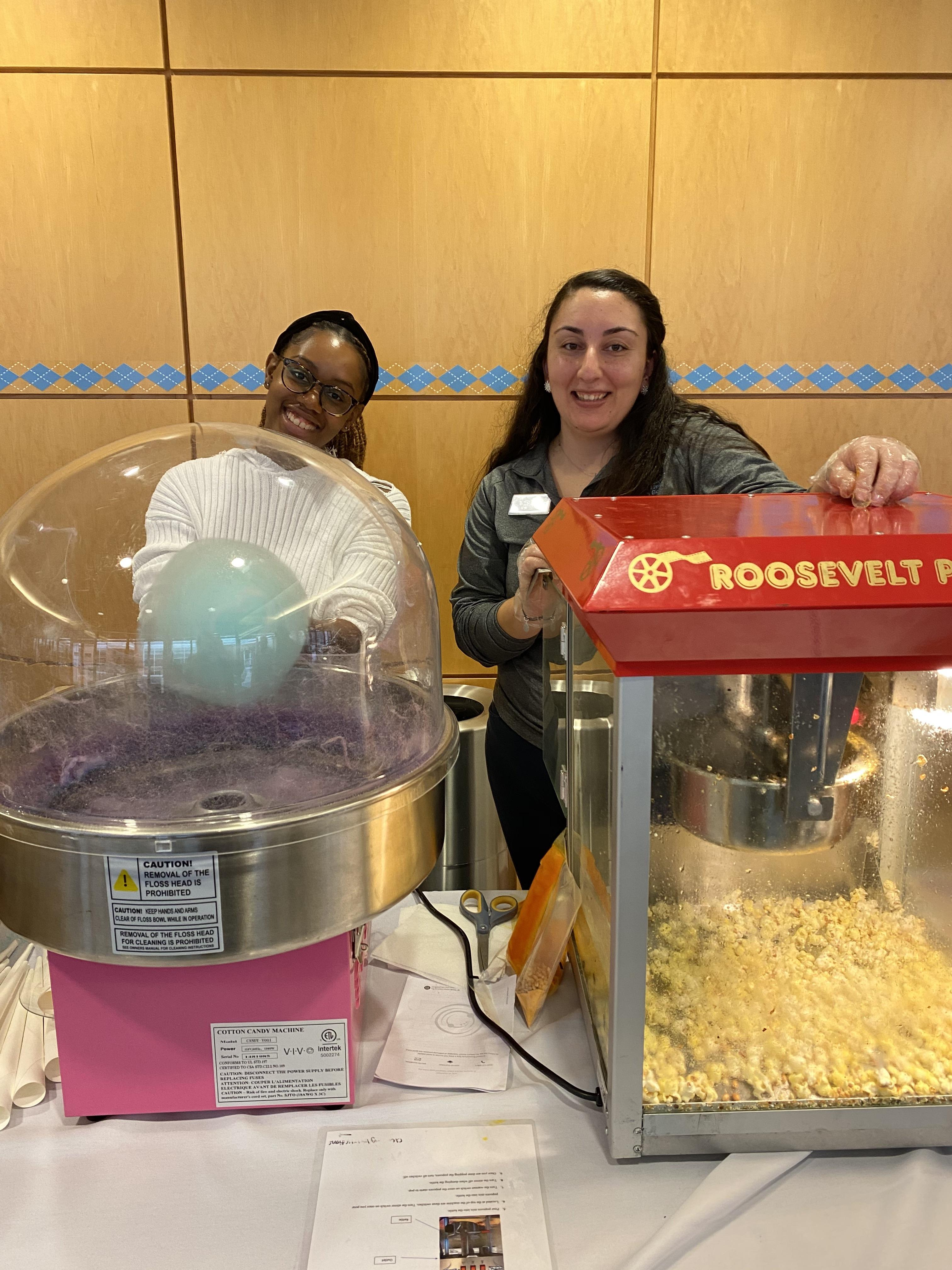employees making snacks for students at job fair