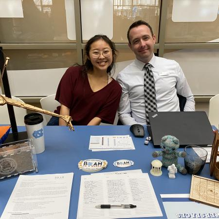 two employers smiling at table